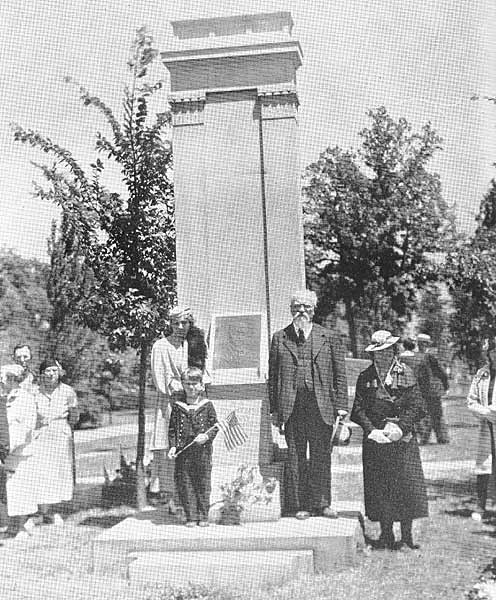 Dr. Jonas Sliupas and family, standing at his uncle's grave