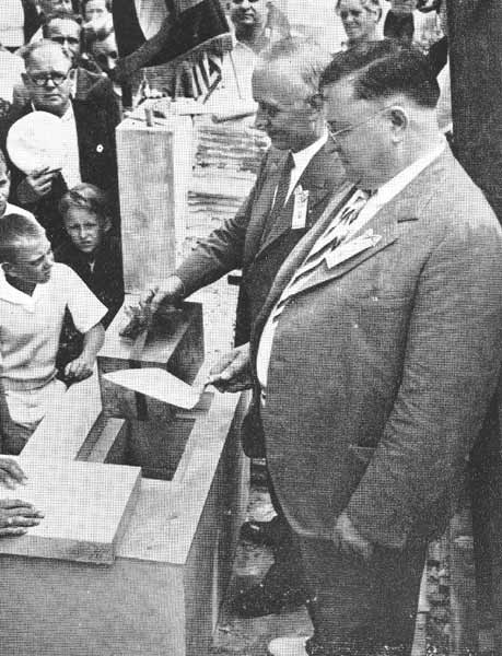 Placing a time capsule into the cornerstone of the new building